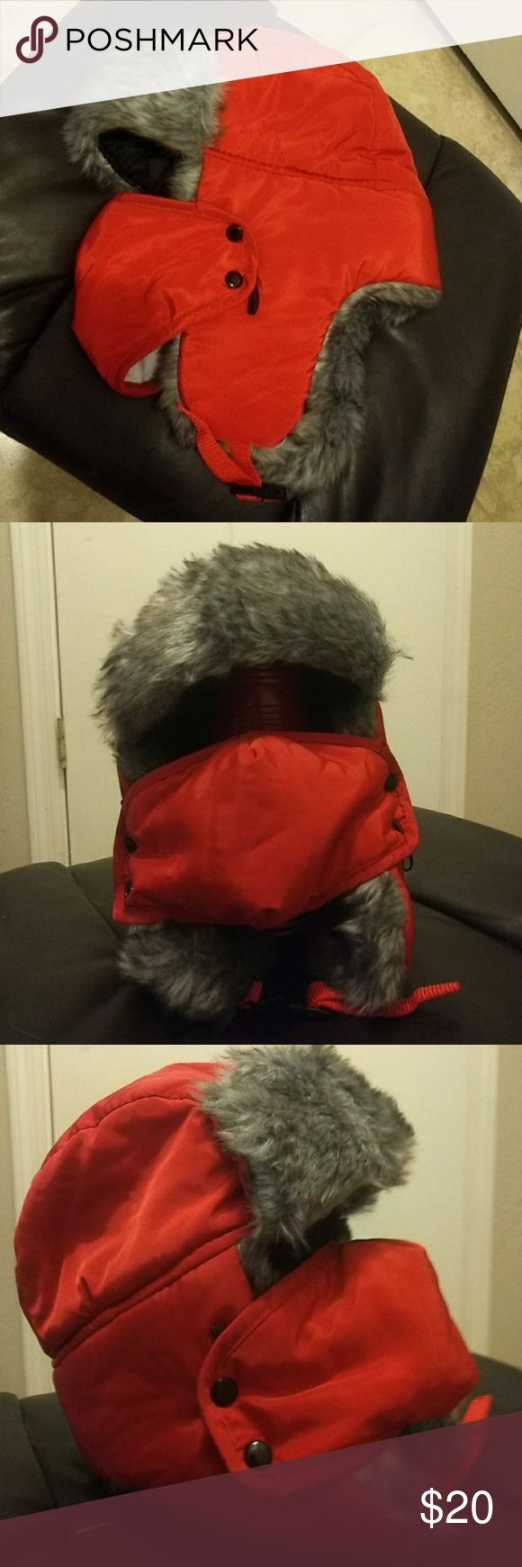Snowboarding hat Red snowboarding hat with grey (faux)fur & black on the inside. Has a chin buckle and snaps to hold on the mouth cover! The cover also has elastic straps if you'd rather wear around your ears. Like new condition! Accessories Hats
