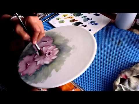 China painting roses on porcelain.