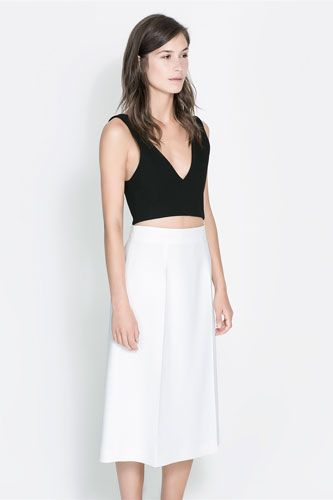 Black cropped top and white skirt