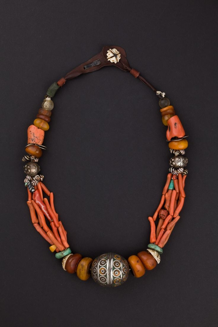 Western Anti-Atlas, Morocco | Silver, enamel, coral, amber, shell, amazonite, glass and leather Berber necklace. ca. 1st half 1900s.