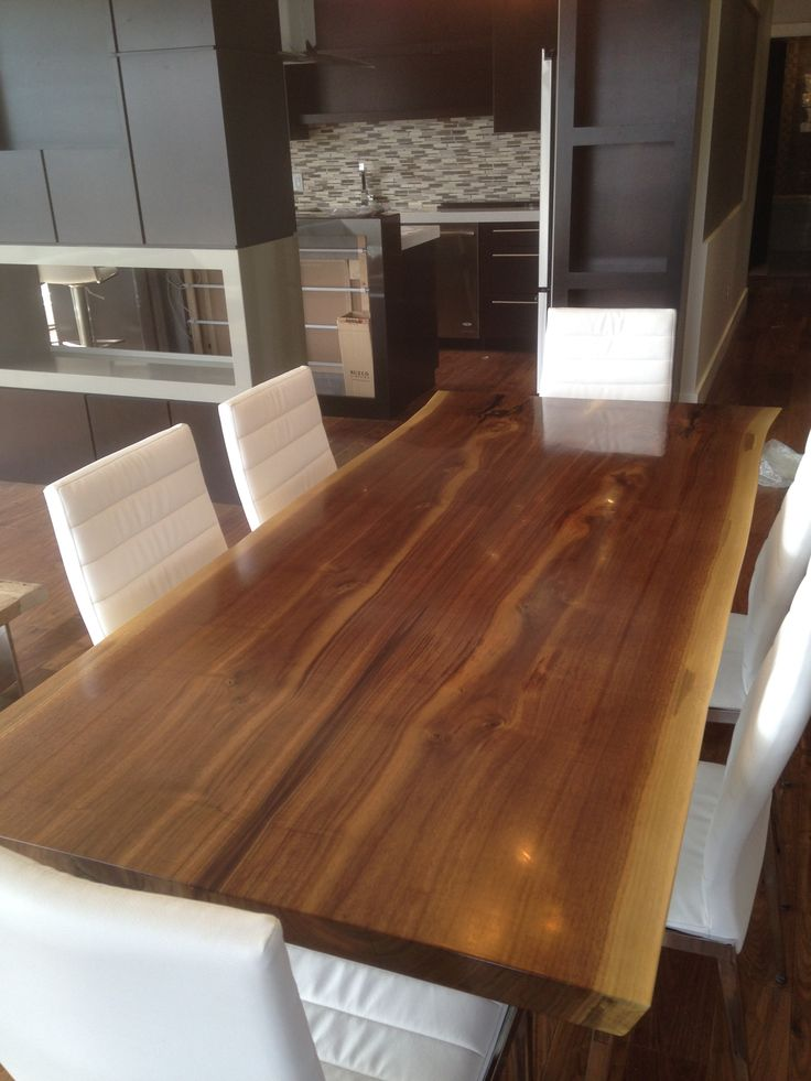 Live edge walnut dining room table by H. G. Carpentry & Joinery. Winnipeg, MB. Canada