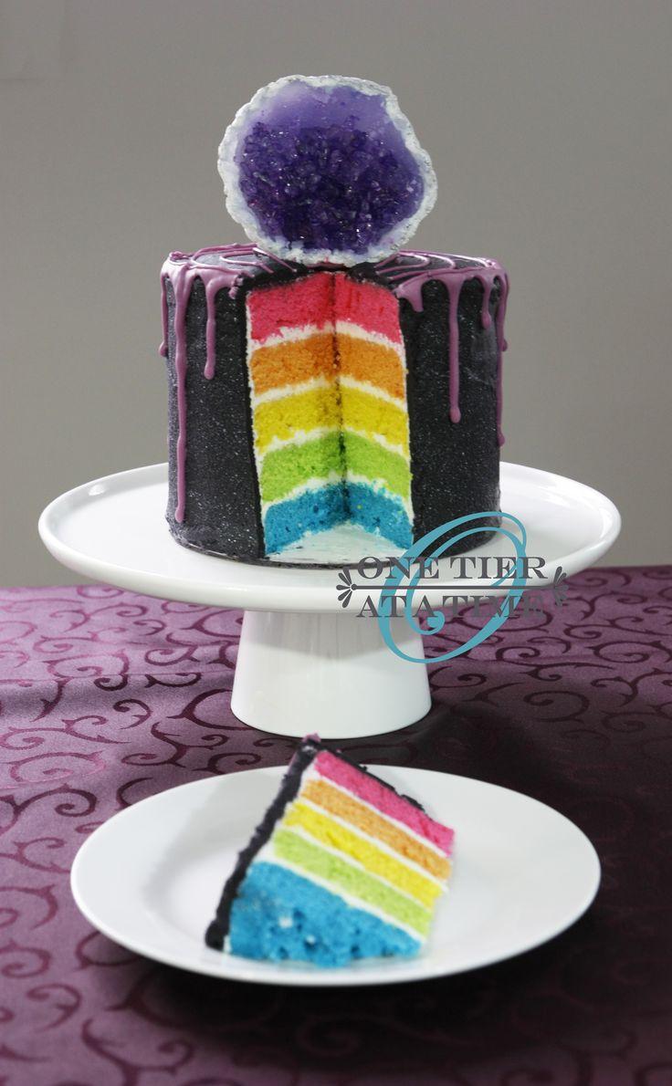 Amethyst geode drip cake - black ganache with purple chocolate drip.  Rock candy and sugar crystal geode. Rainbow layer cake.