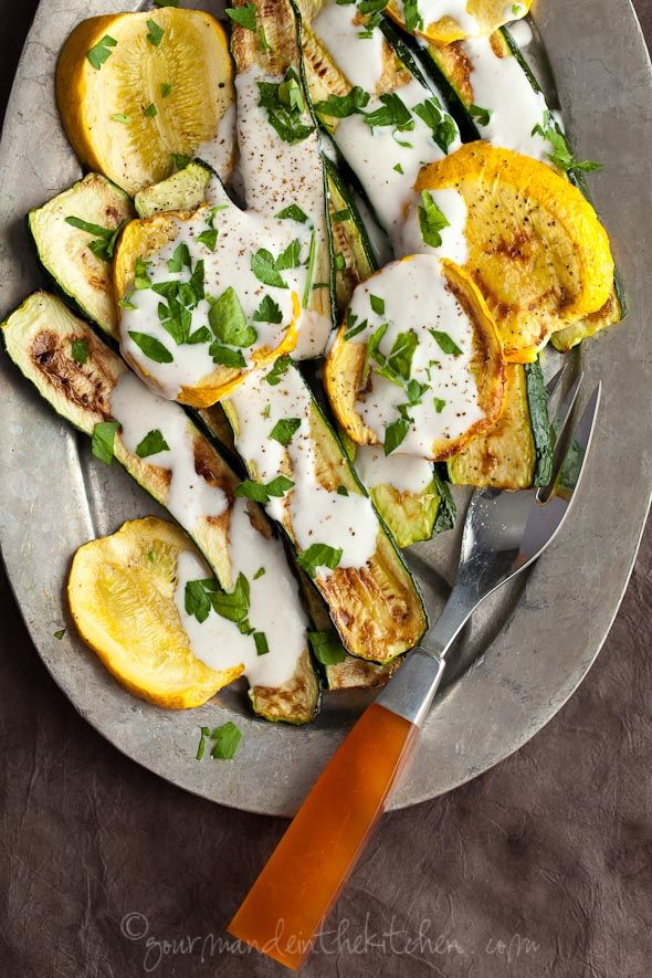 Grilled zucchini and summer squash with yogurt cumin sauce.