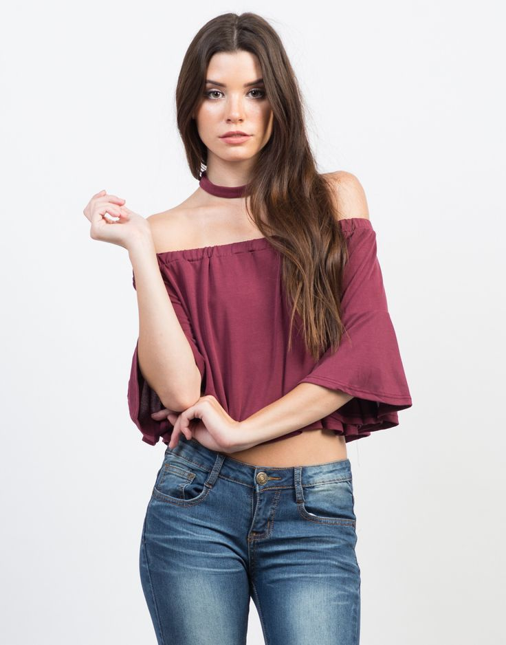 Let's take it back to the 70s in this Bell Sleeve Choker Top. Pair this cute top with high waisted ripped denim shorts, lace-up sandals, and a crossover body bag.