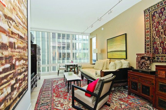 Collector's Contemporary Home Is Perfectly Enhanced By Antique Serapi Carpet on Floor and High-Collectible Caucasian Rug Adorning The Wall http://www.claremontrug.com/modern-downtown-condo/collectors-contemporary-home-is-perfectly-enhanced-by-antique-serapi-carpet-on-floor-and-high-collectible-caucasian-rug-adorning-the-wall/