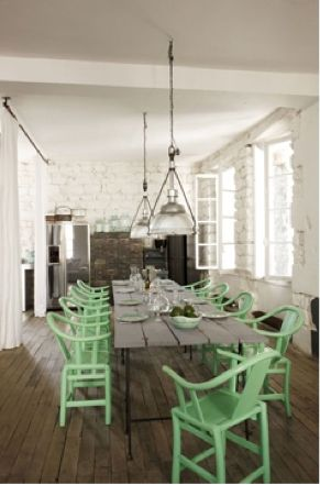 Gray table to match cabinets, brightly painted chairs