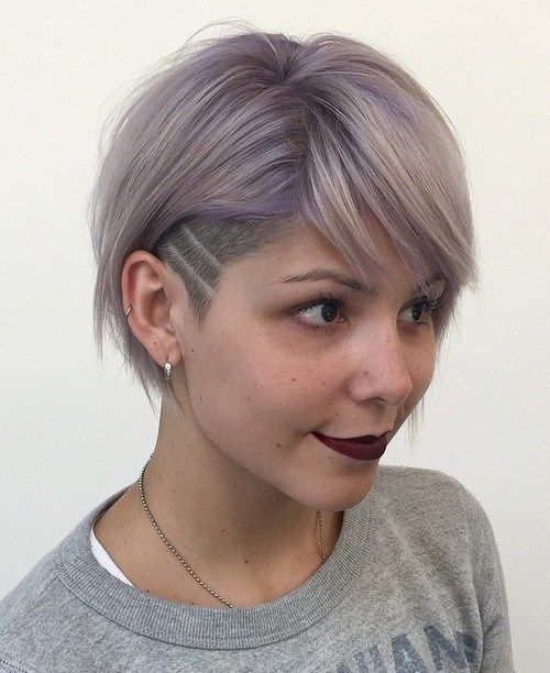 short women's hairstyle with temple undercut