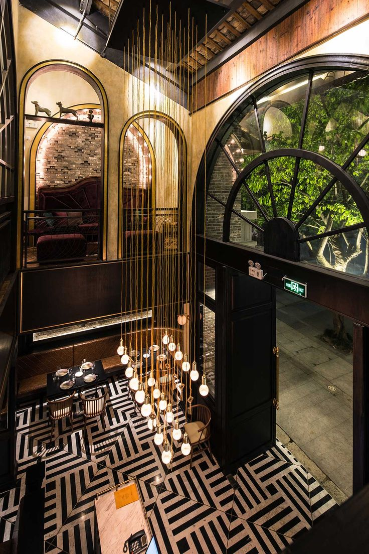 The Locksmith, designed by Studio Y. A forgotten mansion comes alive with marble flooring, brass accents and dark veneer