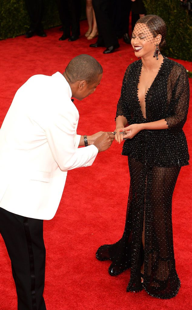 Beyoncé loses her ring on the Met Gala red carpet, so Jay Z finds it and stages a mock proposal. Too cute!