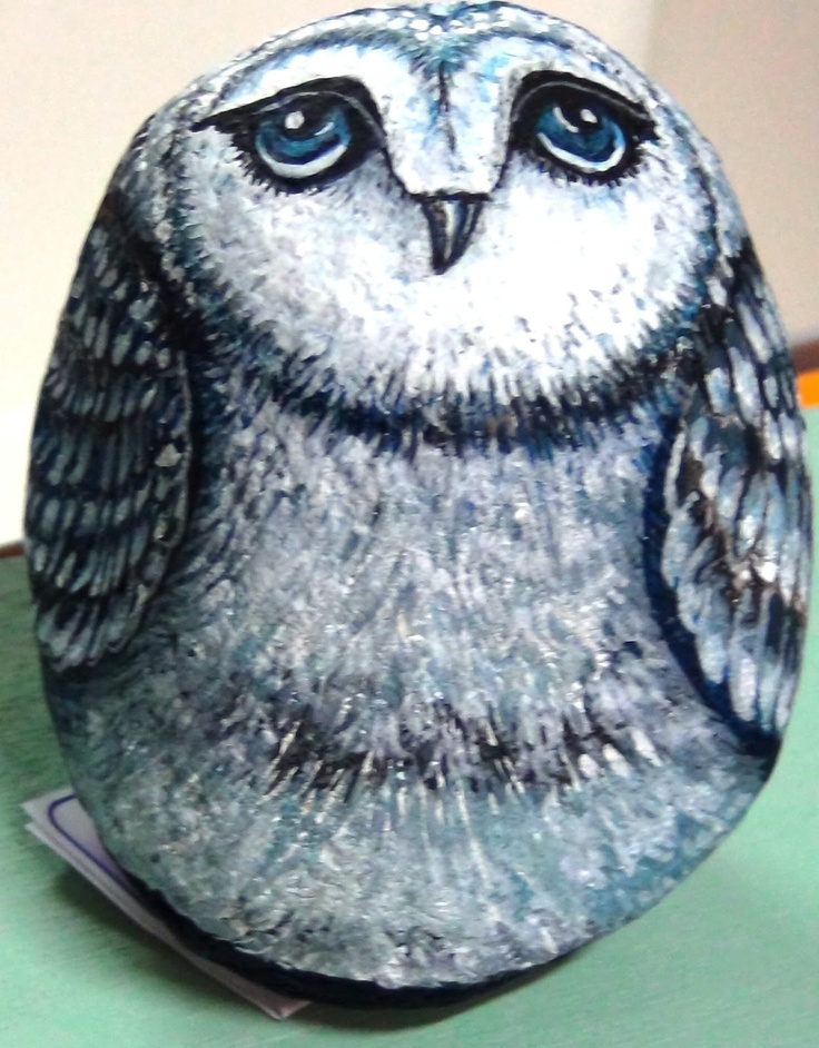 beautiful owl painted onto a large rock. Door stopper?