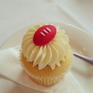 afl Football cupcakes for wedding cake! #aflwedding #cupcake #afl #sherrin #acmcgwed #weddingcake #weddingcupcakes
