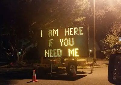 As he's walking all alone through the empty city in the dead of night, suddenly the sign flashes on.