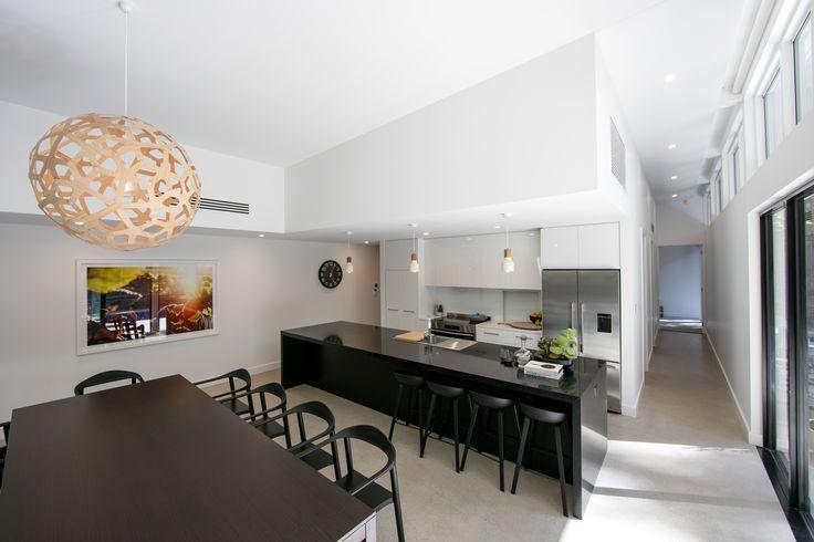 Ross Didier table, trubridge pendant, dining room, kitchen.