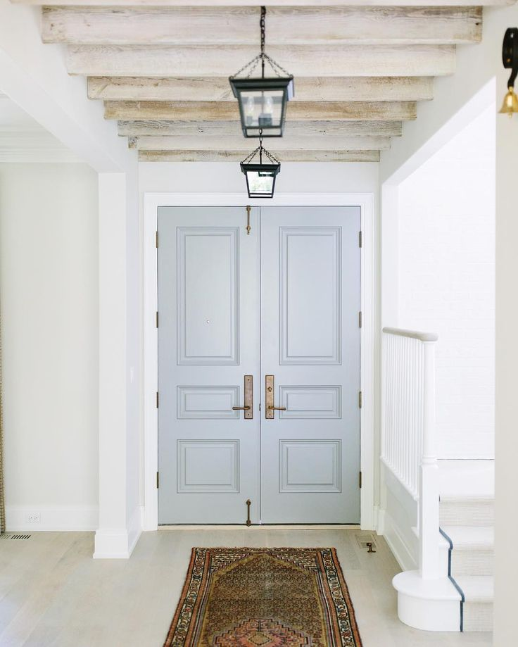 Door color is: Cape May Cobblestone by Benjamin Moore... looks blue gray here but looks gray in other pics in Google images.