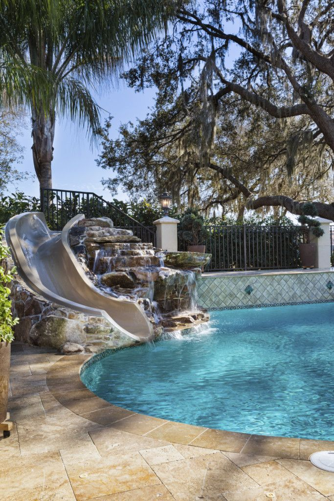 17 best images about pools on pinterest swimming pool for Above ground pool waterfall ideas