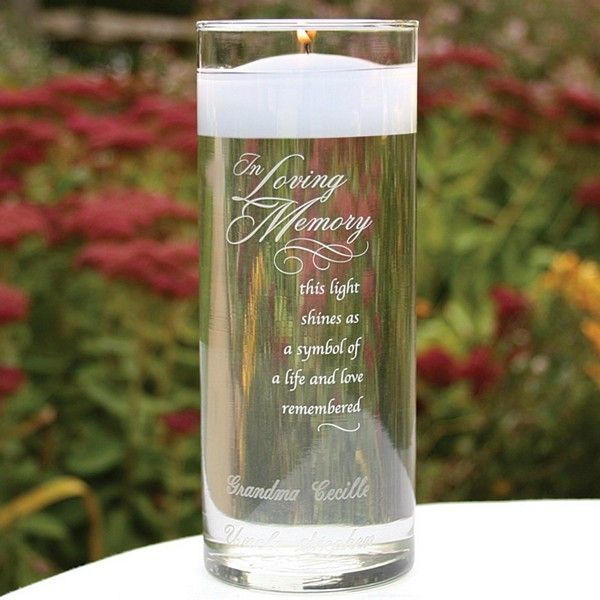Use a glass memorial candle custom engraved with the names of family and friends who are with you in spirit on your wedding day to remember them during your wedding ceremony and reception. After your wedding, keep this keepsake memory candle vase in your home to honor loved ones every day. The front of this vase is inscribed with the phrase 'I Loving Memory, this light shines as a symbol of life and love remembered'.
