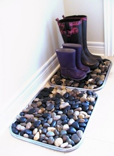 Make a cheap and easy pebble boot tray. / 24 Easy Ways To Get Your Home Ready For Winter (via BuzzFeed):