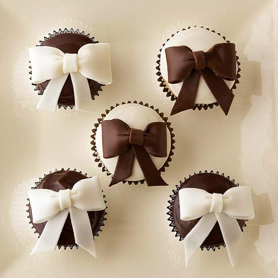 These creative cupcakes with handmade chocolate ganache bows are a perfect party treat. Recipe: http://www.bhg.com/recipe/cupcakes/black-and-white-bows/?socsrc=bhgpin051812