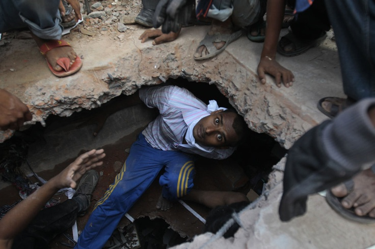 Horror in Bangladesh | A Bangladeshi rescuer looking for survivors emerges from beneath a concrete slab of a building that collapsed Wednesday in Savar, near Dhaka, Bangladesh,Thursday, April 25, 2013. Photo: AP / A.M. Ahad