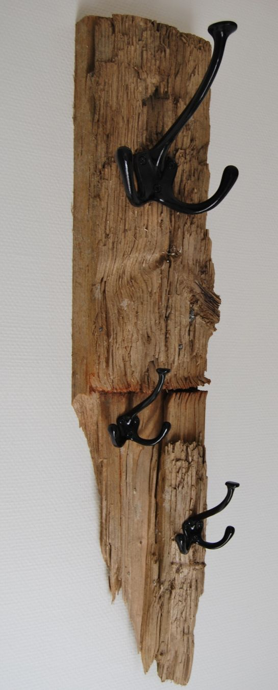 Found a piece of driftwood one the beach? Add a hook or two and make it into a coat hanger or jewelry hanger!