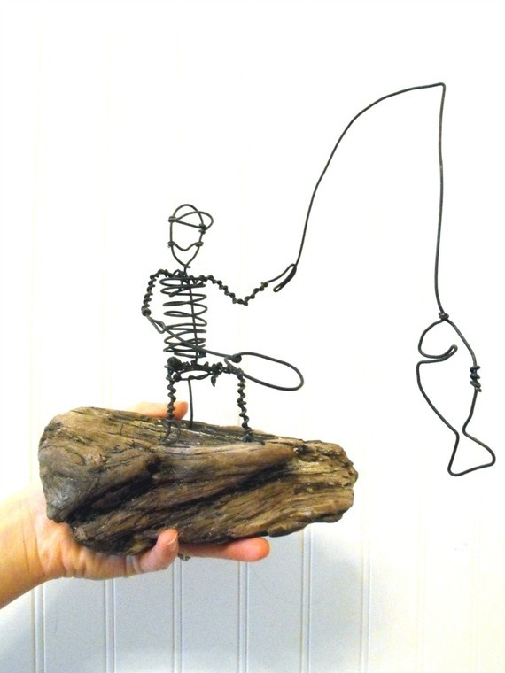 wire fisherman on driftwood