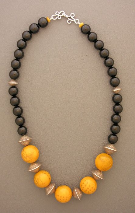 Necklace |  Anne Holland ~ Dorje Designs.    Five bakelite beads with wonderful pictures of Chinese figures  and characters, with sterling silver bicone saucer beads, black  onyx beads, and a fancy sterling silver hook and eye clasp.