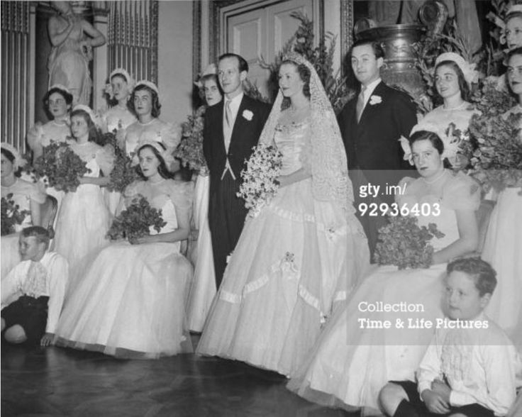 UNITED KINGDOM - JULY 01, 1948: At his wedding to Raine McCorquodale, Gerald Legge watching as his bride receives a kiss from a guest at the wedding reception. (Photo by William Sumits/Time & Life Pictures/Getty Im