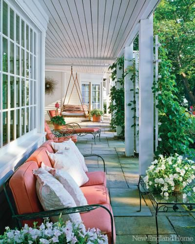 The cheerful covered porch is a great spot to catch a nap, enjoy a cocktail, and watch the boats go by in this home designed by Douglas Dean Tefler and Dolores Halpern. Seaside Sanctuary | New England Home Magazine