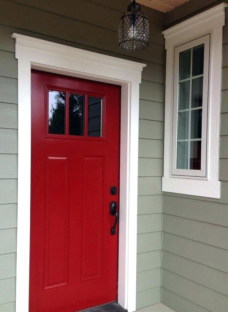 This Beautiful Painted Exterior Front Door Has Been Adorned With Fluted Columns And A Large Pediment Exterior Front Doors Exterior Entry Doors Front Door Trims
