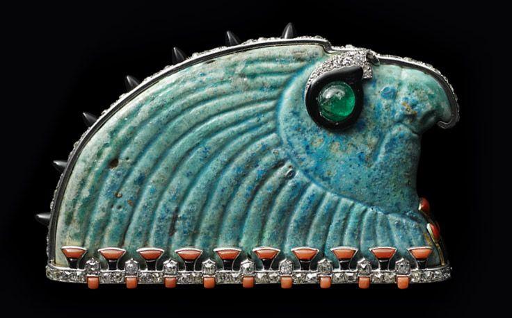 Horus Brooch, Cartier Paris, 1925, Platinum, gold, blue Egyptian faience, diamonds, emerald, coral, onyx, black and red enamel.