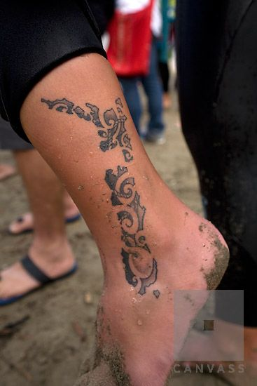 Map of New Zealand tattooed in Maori style.