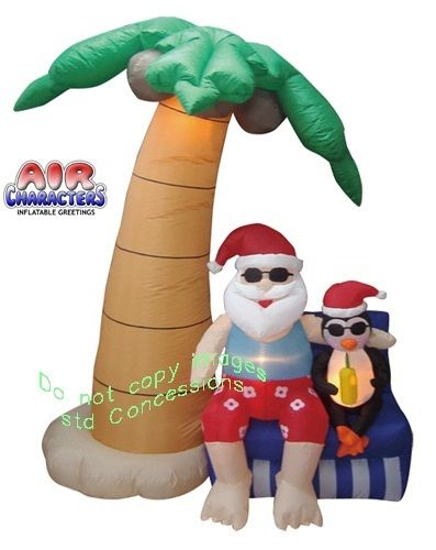 "Santa on Tropical Vacation.  It's Christmas in July...and Santa and Penguin are making the most of it...tropical style.  Very limited edition of this Tropical Christmas Inflatable.  Looks like Santa and Mr. Penguin are really enjoying some R&R under the Palm Tree.  This inflatable stands 70"" Tall."