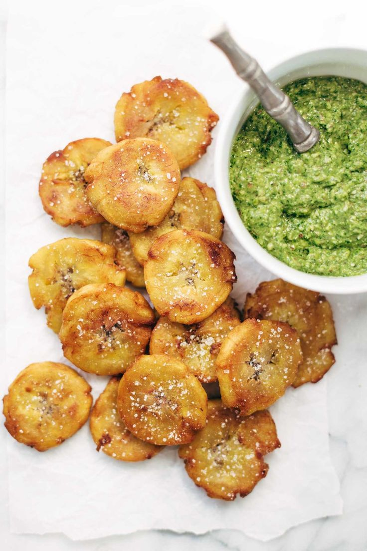 Crispy Salted Tostones - super easy recipe for golden brown bites of perfection with just one ingredient: PLANTAINS! video demo in the post. vegetarian / vegan. | pinchofyum.com