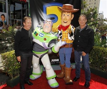Tim Allen, Buzz Lighter, Woody, and Tom Hanks. makes me :D