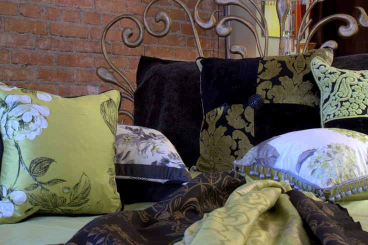 Custom cushions in Chartreuse, Black and White. Prices range from 125.00 to 150.00. If you have cushions and you just want new covers the cost of the feather insert can be deducted.