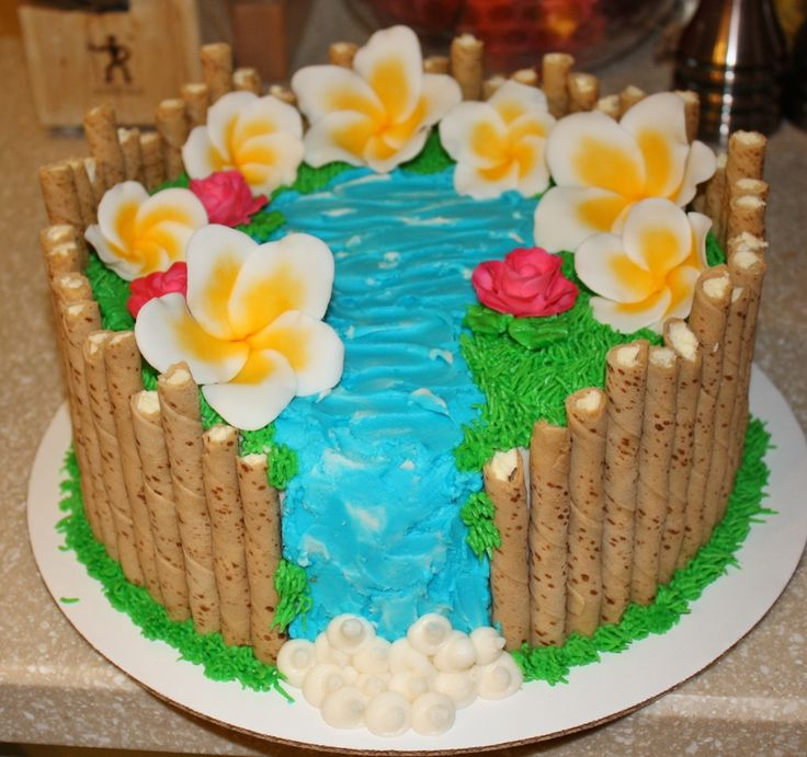 Pirouette cookies surround the outside of the cake, icing decorations,...