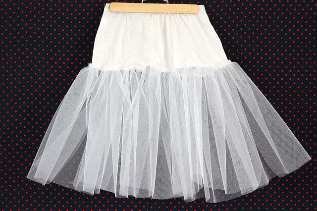 Making your own crinoline is easy—the materials are inexpensive and readily available at any fabric store. Since very little (if any) is meant to show, you don't have to be an expert seamstress either. If you intend for the bottom of the crinoline to show beneath your poodle skirt, you can have fun with the color of the tulle; try...