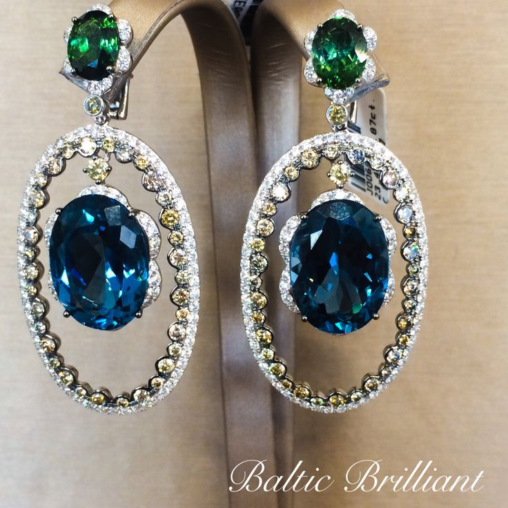 One of a kind Earrings with real diamonds and color stones!
