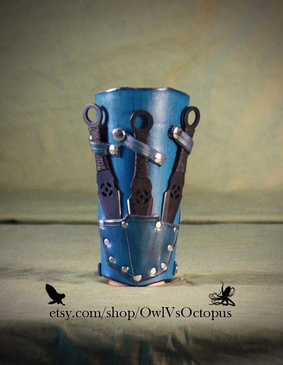 Blue Leather Bracer with Throwing Knives Gorgeous. Must own. Someday. Soon.  haha!