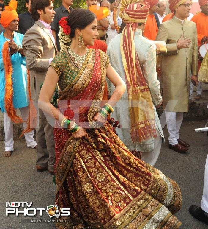 Genelia D'Souza at her brother in law's wedding - such a beautiful bridal Sabyasachi lehenga!