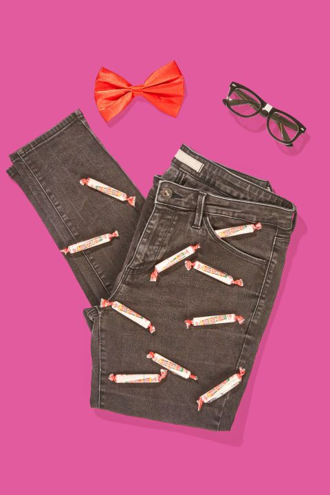 "Smartie Pants: You'll look sweet enough to eat when you slip into some old trousers with Smarties candies hot-glued all over them. Add some ""nerd"" glasses and a bow-tie to complete the look. Find more quick, affordable and easy last minute Halloween costume and outfit ideas here."