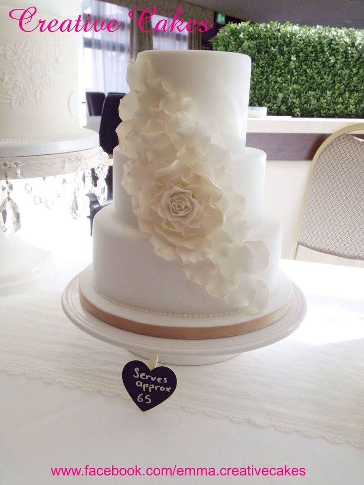 Ivory and gold spreading flower wedding cake