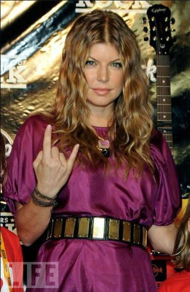 Fergie throwing up illuminati hand sign. If you think she's cool, then I hope you think Hell is cool, too, because these celebrities are leading you down a path of destruction. They are leading you away from God. That is the truth.