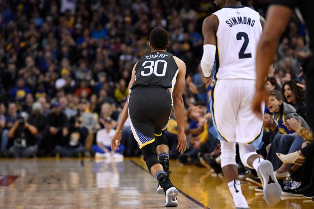Golden State Warriors' Stephen Curry (30) reacts after scoring a three-point basket against the Memphis Grizzlies during the second quarter of their NBA game at the Oracle Arena in Oakland, Calif., on Saturday, Dec. 30, 2017. (Jose Carlos Fajardo/Bay Area News Group)