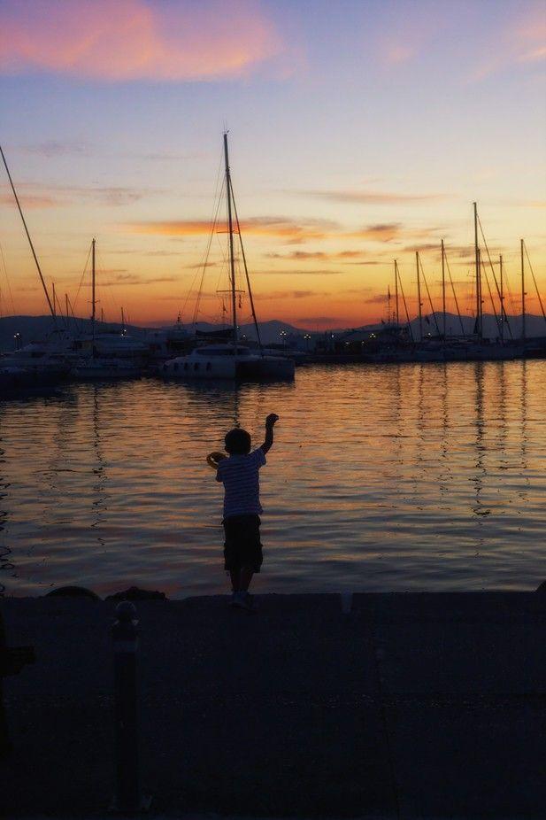 Fishing at sunset. Aegina Island Greece.