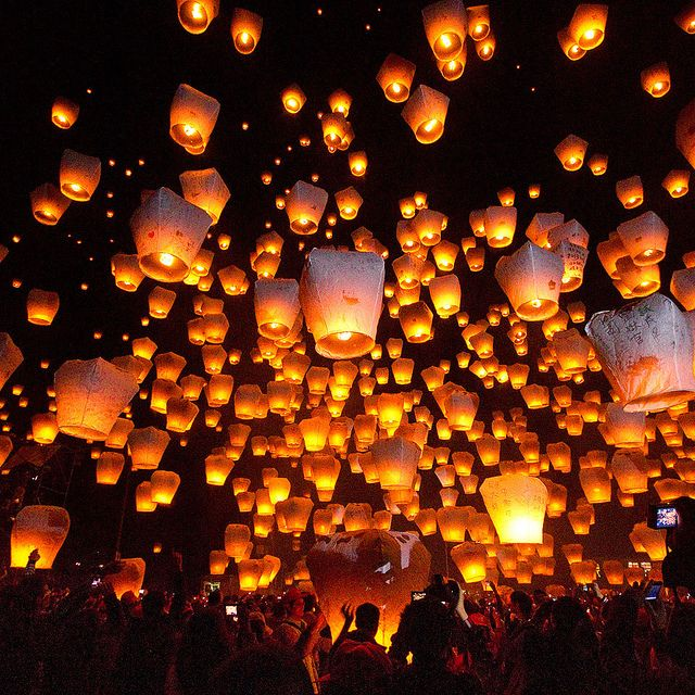 The Magic Lights of Lantern Festival (Taiwan). 'One of the oldest of the lunar festivals, the Lantern Festival celebrates the end of the New Year's festivities. Making the mundane surreal and the commonplace magical, the little mountain village of Pingxi takes simple paper lanterns and releases them en masse into the night sky.' http://www.lonelyplanet.com/taiwan/northern-taiwan/pingxi-branch-rail-line