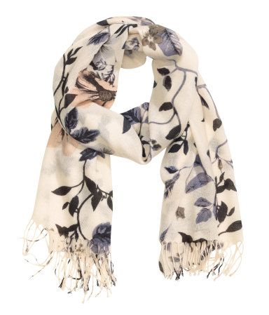 Lightweight scarf in airy woven fabric with a printed floral pattern & fringed ends. | H&M Accessories