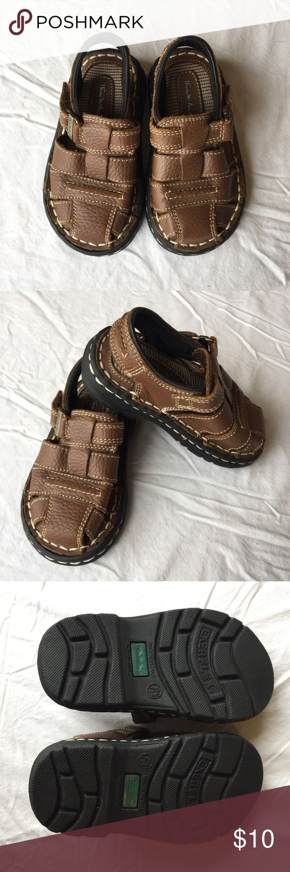 EUC Toddler Boys 7.5W sandals Thom McAn toddler boys' sandals, size 7.5W. Brown, with leather uppers. They seem to run small, so they might fit a little guy who's currently in size 6. Barely worn, like new. Thom McAn Shoes Sandals & Flip Flops