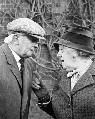 Stringer Davis  as Mr. Stringer with wife Margaret Rutherford  as Miss Jane Marple in Murder at the Gallop