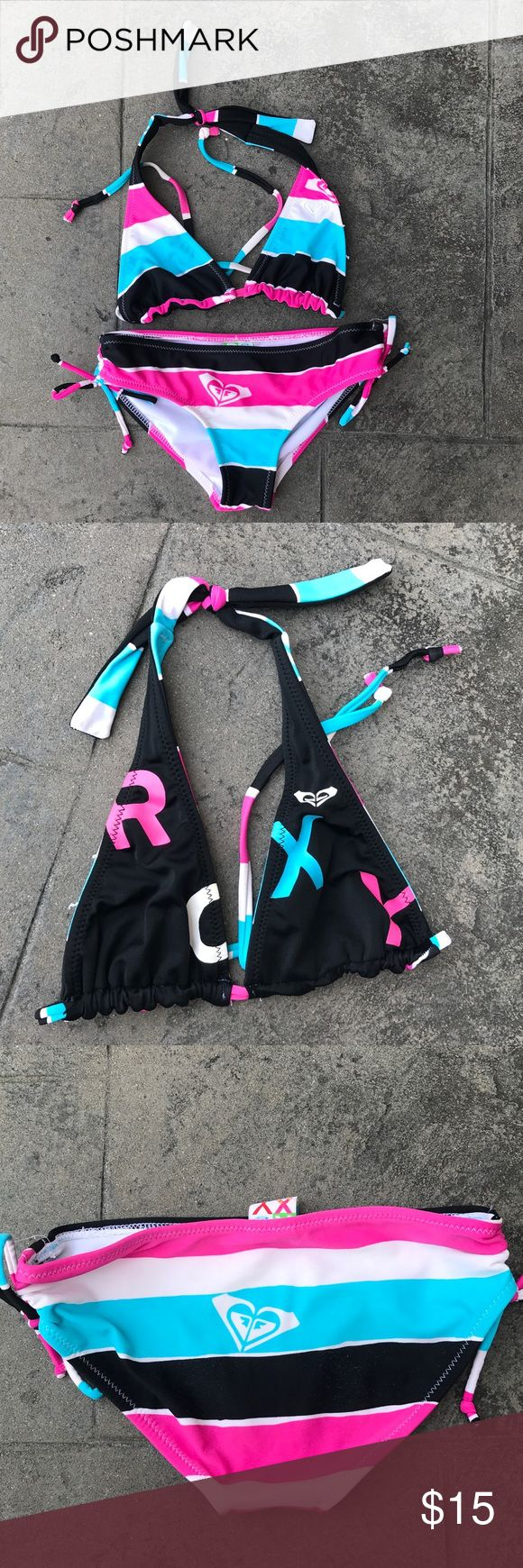 ROXY girl's swimsuit ROXY girl's 2-piece swimsuit, size 10.  Black, hot pink, white and turquoise.  Top is reversible, with one side in stripes and the other with ROXY lettering.  Super cute and fun!  Great condition. Smoke-free/pet-free home. Roxy Swim Bikinis